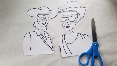 Cutouts of shapes that makes one smiling figure when put together.