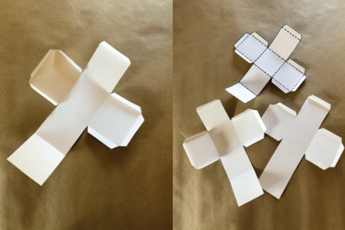 Dice cut-outs with folded flaps.