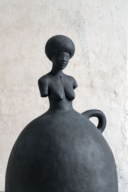 A sculpture by Simone Leigh of a female figure.