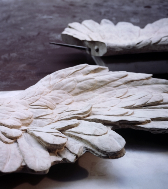 A color photograph depicts two plaster casts of the wings of the sculpture the Nike of Samothrace.