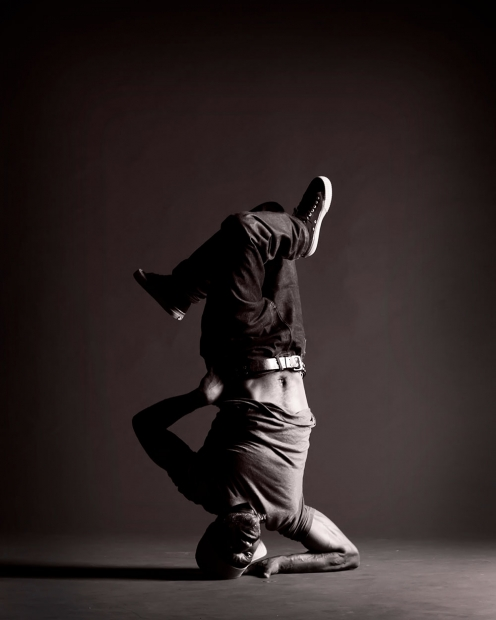 Black and white photo of man dancing upside down