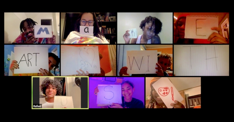 """A video-conference screen capture shows 11 participants holding up written letters that spell out """"Make art with us."""""""