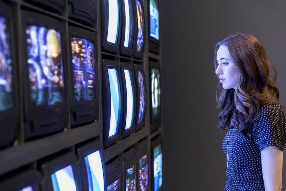 Visitor observing Nam June Paik video installation