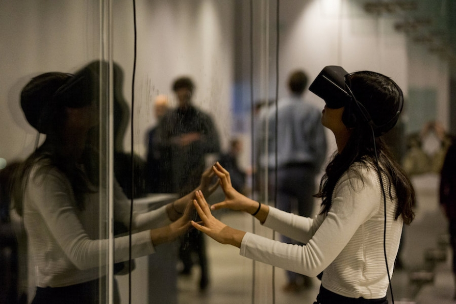 Visitor with VR headset on in Art in the Age of the Internet