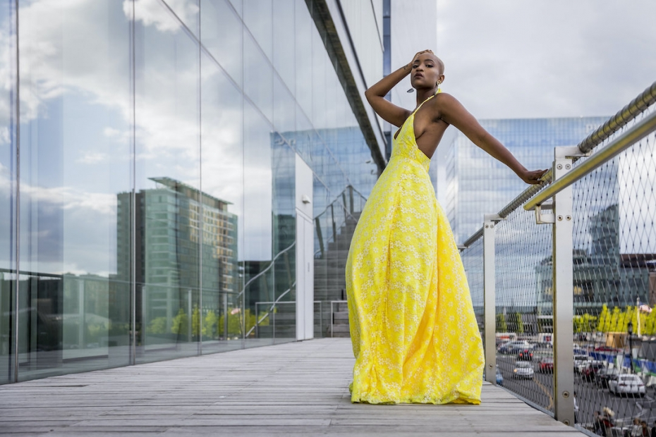 Model in yellow dress posing outside the ICA building