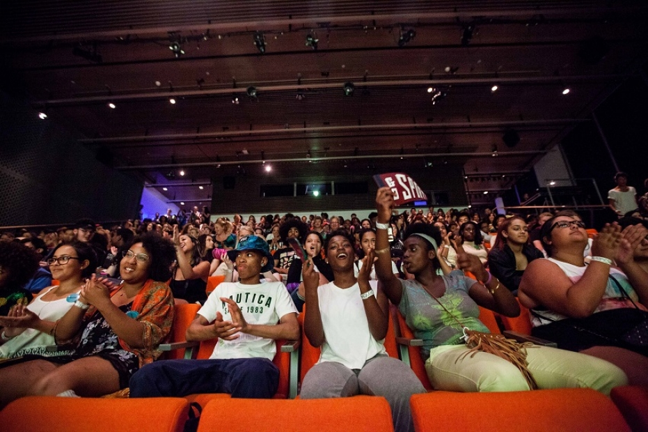 Teens watching performance in theater