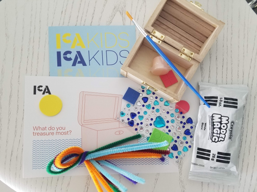 The kids activity art kit disassembled with a small treasure chest and art supplies