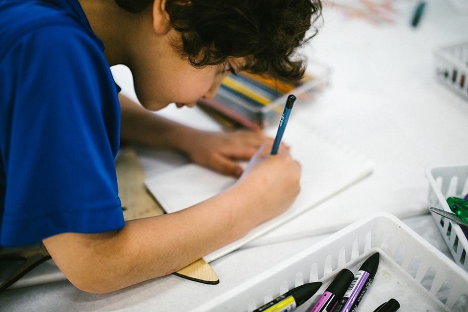 Boy making a flying fish in Art Lab