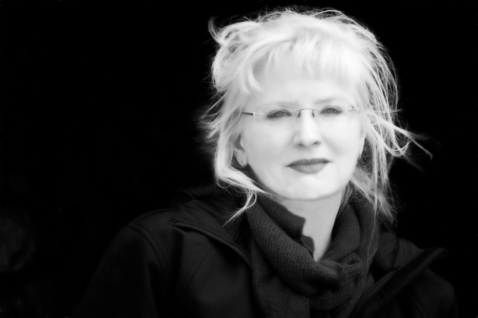 Black and white photo of woman with light hair and glasses