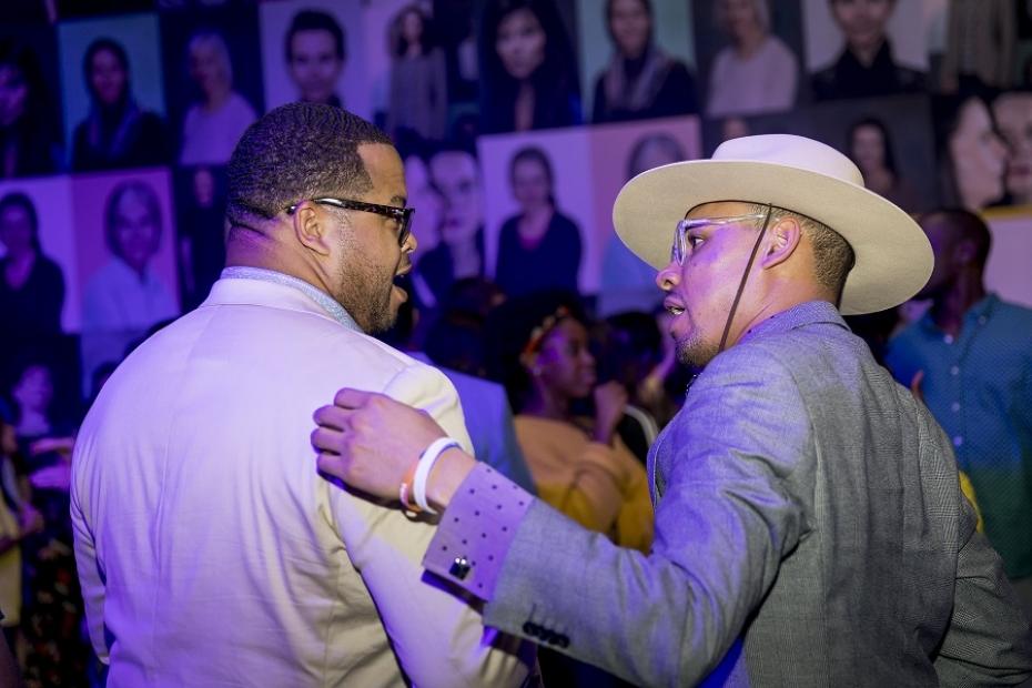 Two peopel talk on dance floor