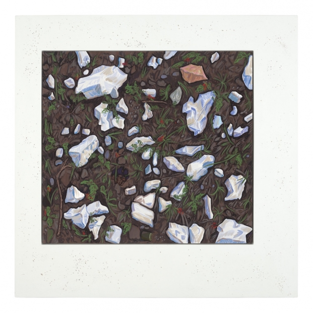 A painting of rocks and greenery on a dark brown ground, in a wide white frame with speckles.