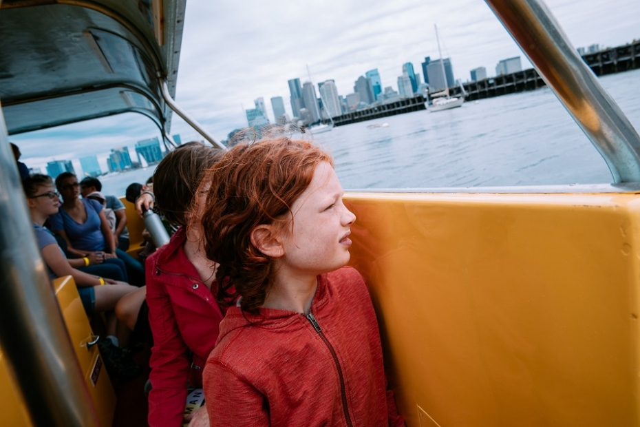 Child on a water taxi looking out over the water