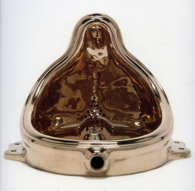 """A shiny bronze replica of Marcel Duchamp's 1917 """"Fountain,"""" a commercially manufactured urinal."""