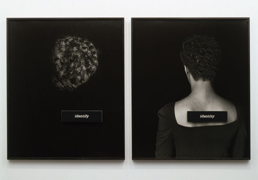 """Two black-and-white photographs with black backgrounds, one of a section of dark, curly hair with a placard reading """"identify"""" and one a portrait of a  Black woman in a scoop-neck black top shown from the back with a placard reading """"identity"""" affixed to the bare skin of her upper back."""
