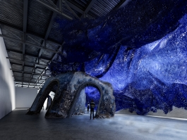 A rendering of sculpture that appears to be a sinking ruin and blue waves in the ICA's seasonal exhibition space, the Watershed