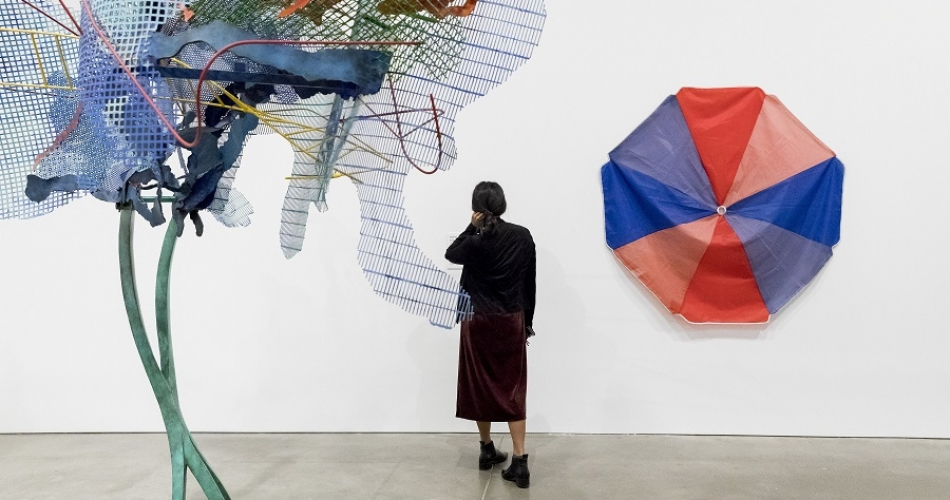 Vistior looking at art in ICA Collection: New Acquisitions exhibtion