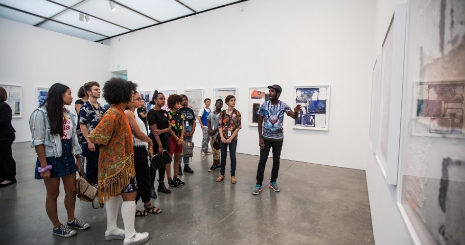 Teens at 2015 ICA Teen Convening in the galleries looking at art