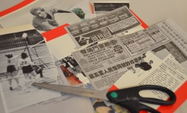 Scraps of cut-out newspapers and a pair of scissors on a surface.