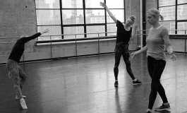 A black and white photo of three dancers in a studio.