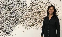 Portrait of Bennie Flores Ansell in front of her work