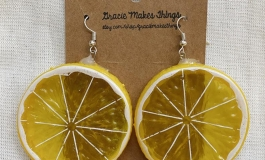 Earrings resembling lemon slices.