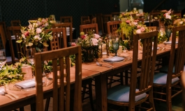 A table setting at the ICA with floral centerpieces.