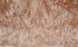 A horizontal artwork of copperish brown swirling together with a lighter neutral color. Medium is not apparent.