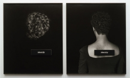 "Two black-and-white photographs with black backgrounds, one of a section of dark, curly hair with a placard reading ""identify"" and one a portrait of a  Black woman in a scoop-neck black top shown from the back with a placard reading ""identity"" affixed to the bare skin of her upper back."